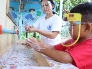 CCDO Teacher with Child washing hands